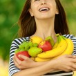 Attractive woman holding fruit — Stock Photo