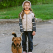 Little girl with terrier - Stock Photo