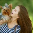 Royalty-Free Stock Photo: Smiling woman with Yorkshire Terrier