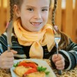 Royalty-Free Stock Photo: Girl-preschooler eats a tasty meal