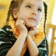 Stock Photo: Girl-preschooler sitting at table
