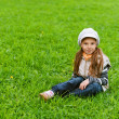 Happy girl-preschooler on green grass — ストック写真