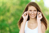 Attractive woman wears glasses — Stock Photo