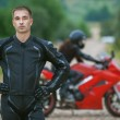 Young male motorcyclist — Stock Photo