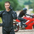 Young male motorcyclist - Foto Stock