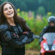 Young female motorcyclist — Stock Photo