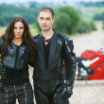 Couple on background of bike — Stock Photo