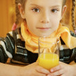 Stock Photo: Girl-preschooler drinking orange juice
