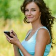 Woman is typing with stylus on device — Stock Photo #12014242