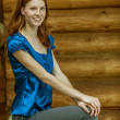 Beautiful young woman in blue blouse — Stock Photo #12407503