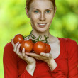Young woman in red blouse with tomato — Stock Photo