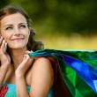 Stock Photo: Womin colorful dress of said cellular phone