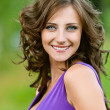 Stock Photo: Young womin purple dress happily smiling