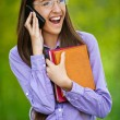 Royalty-Free Stock Photo: Teenage girl on cell phone says
