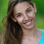 Beautiful smiling teenage girl — Stock Photo #12408292