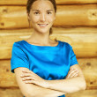 Beautiful young woman in blue blouse — Stock Photo #12408371
