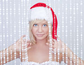 Beautiful smiling young woman in Santa Claus hat — Stock Photo