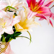 White and pink lily flowers and lace — Stock Photo #11798005