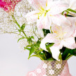 White and pink lily flowers and lace — Stock Photo