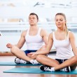 Young in the lotus position - Stock Photo