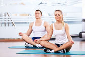 Young in the lotus position — Stock Photo