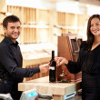 Buying wine — Stockfoto