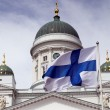 Fluttering national flag of Finland against Helsinki Cathedral — Stock Photo