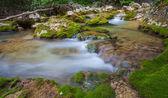 Nice small waterfall on mountain stream — Stock Photo