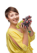 Portrait of attractive smiling girl with grapes — Stock Photo
