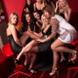 Image of group pretty girls in night club - Foto Stock