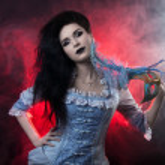 Beautiful Halloween vampire woman aristocrat over black-red background — Stock Photo #10835224