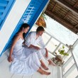 Romantic young couple in tropical beach house — 图库照片