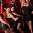 Image of pretty girls dancing in night club - Stok fotoğraf