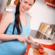 Stock Photo: Pregnant woman in kitchen