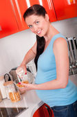 Pregnant woman in kitchen — Stock Photo