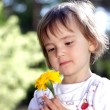 Cute girl with yellow flower — Stock Photo