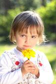 Little girl with yellow flower — Foto de Stock