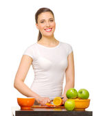 Young girl with fruits — Stock Photo