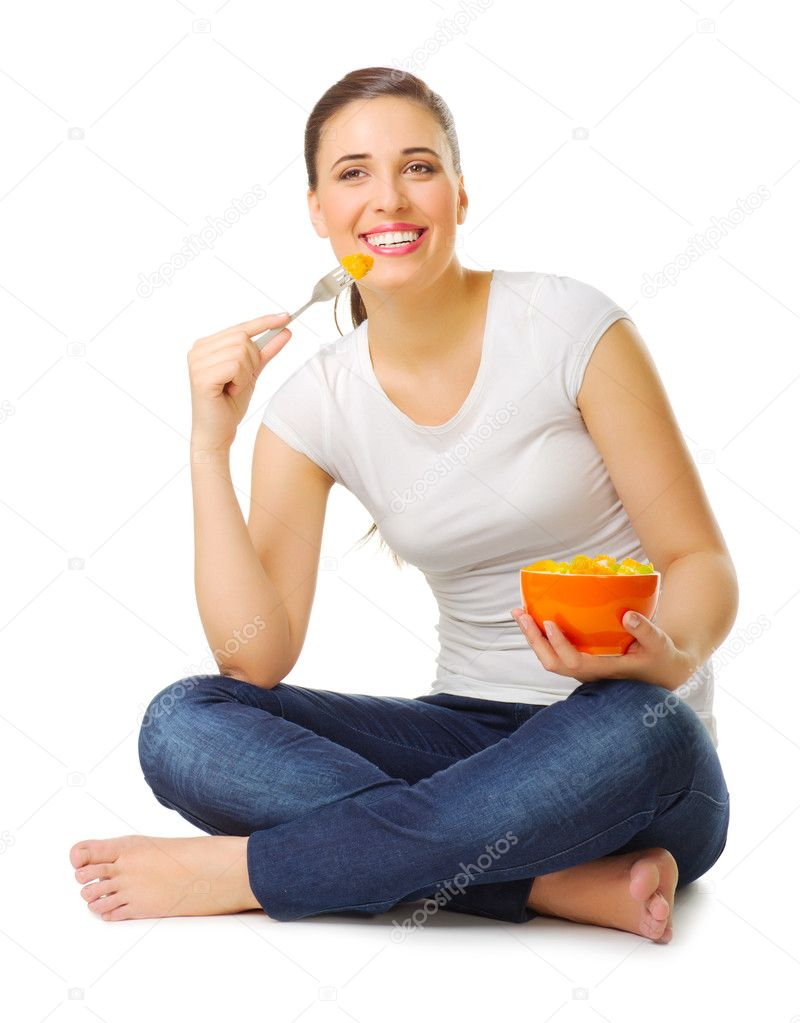 Young girl eat fruit salad isolated  Stock Photo #11066500