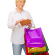 Senior woman with bags and wallet — Stock Photo