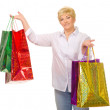 Senior woman with bags — Stock Photo