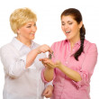 Senior woman giving keys to her daughter — Stock Photo #11465108