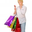 Senior woman with bags and credit card — Stock Photo #11465110