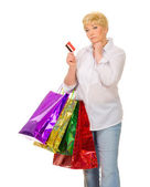 Senior woman with bags and credit card — Stock Photo