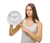 Young woman with clocks — Stock Photo