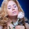 Stock Photo: Frozen girl with rose flower