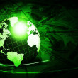 Shining green globe with dollars - Stock Photo