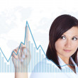 Woman touching business chart over white — Stock Photo