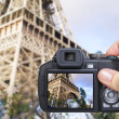 Hand making shot of eiffel tower by camera — Stock Photo #11308911