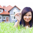 Woman holding keys to house — Stock Photo #11804444